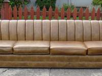 This is a great vintage vinyl leather couch that just