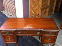 This is a vintage walnut bedroom vanity set with burled