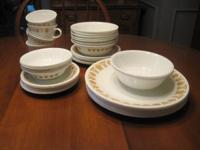 Dishes in butterfly gold pattern. Includes 8 dinner