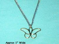 "This butterfly necklace is goldtone. It hangs 9"" long"