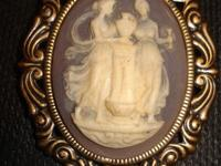 A beautiful vintage cameo like brooch/pin that is oval