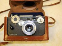 I am selling my grandpa's old camera, I don't know much