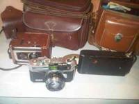Set of three vintage cameras and accessories, bags,