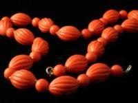 Vintage 40's or 50's orange Necklace 23 inches long.