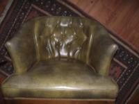 Olive green vintage vinyl resting chair, button cushion