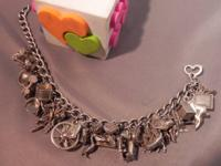 This charming vintage sterling silver appeal bracelet