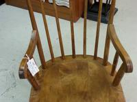 Adorable vintage child's wooden rocking chair. Sturdy