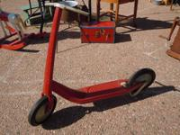 Vintage Childs Red Metal Scooter.  In good working