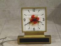 Four Roses whiskey illuminated clock display dating