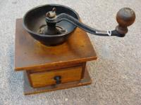For Sale: An antique wooden and iron coffee mill, in