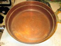 Old copper pan with wood deals with. almost a serving