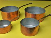 4 vintage copper pots all are of the same matching set.