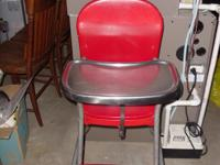 This vintage red high chair by Cosco is where many of
