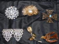 Old costume jewelry for sale. Lots of pins and clip on