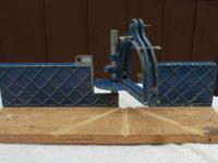We have two vintage Craftsman Miter Boxes.  They both