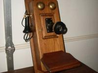This vintage design phone is wired with a dial pad and