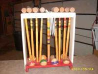 This is a very nice, old croquet set. Nothing missing.