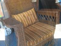 Here we have a lovely dark wicker chair from the