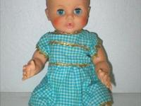 This 1960's vintage doll has gorgeous blue eyes that