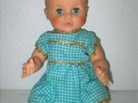 This 1960's vintage doll has beautiful blue eyes that