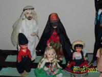 collection of seven dolls. all are in good condition.