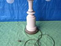 This is a vintage lamp with two sockets. Each arm has
