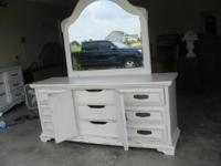 I have for sale a vintage all wood beautiful  dresser.