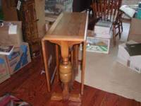 VINTAGE DROP LEAF TABLE. BUILT STURDY WITH REAL HARD