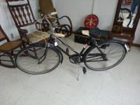 You are considering a vintage Dunelt Cruiser Bicycle.