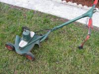 This item is a vintage electric mower that still works.