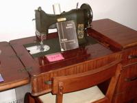 This is a vintage White Series 77 Electric Sewing