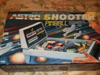 A 1980'S TABLETOP PINBALL GAME (ELECTRIC). PLAYS JUST