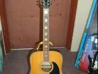 For sale an Epiphone FT-165 12 string acoustic guitar