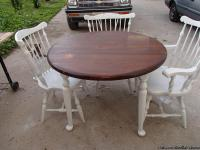 The table is round and 42 inches and is two toned. The
