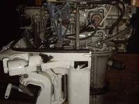 Three motors:. 1. 1958 Evinrude 35 HP Lark. Exceptional