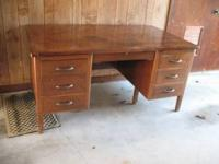 "Vintage executive desk. The desk measures 34"" deep, 60"""