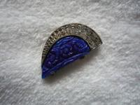 Fishel Nessler brooch. Unknown blue stone sculpted with