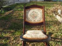 Vintage, older rocking chair that folds slimline and