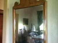 Mirror has distressed markings characteristic of old