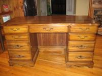This vintage executive desk is pristine solid wood and