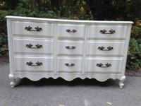 This gorgeous all wood worn-out trendy French 9 drawer