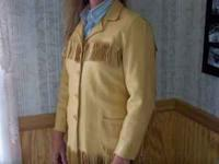 Buckskin colored leather jacket , womens size small.