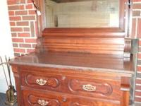 VINTAGE WALNUT DRESSER WITH A MARBLE TOP SELLING FOR