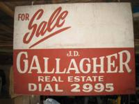 "Old Gallagher realty sign. 2-sided. Wood. 18"" x 24""."