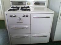 Vintage 1950's stove/oven works well, plenty of storage