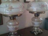 I have two vintage glass hurricane lamps for sale. They