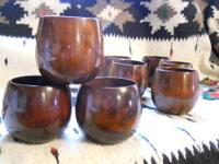 Set of eight vintage teak roly polys made mid 20th