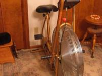 Gold Schwinn Airdyne stationary bike in super working