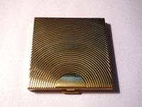 This is an antique Dunhill Clearview compact . Gold
