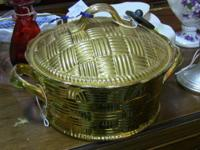 Beautiful gold-colored metal casserole dish. Measures